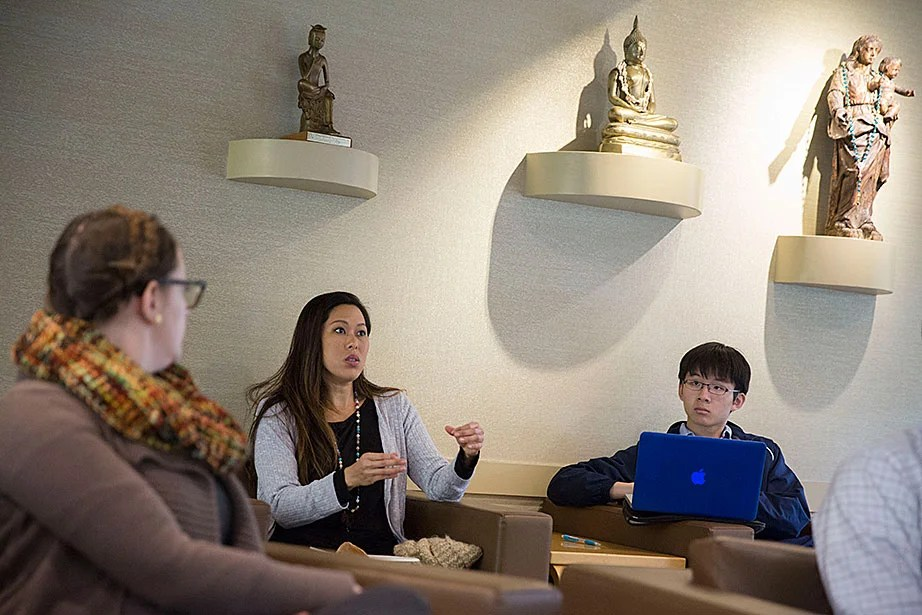 "Vicky Lee (left) and William Wang '20 discuss ballot questions during ""Religion in the News: How Shall We Vote?,"" a lunchtime event in the CSWR common room."