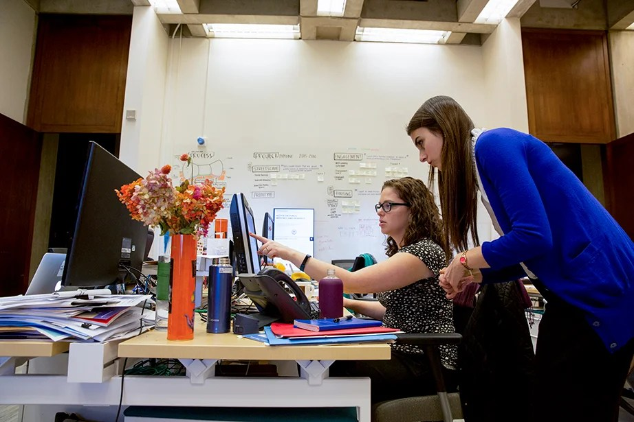 Inside City Hall, Lender (right) works with Ilona Kramer, the program director in the Mayor's Office of New Urban Mechanics at Boston City Hall.