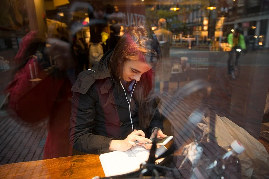Returning to Harvard for a meeting and to interview prospective future fellows, Lender starts her morning by checking her email at Starbucks in Harvard Square.