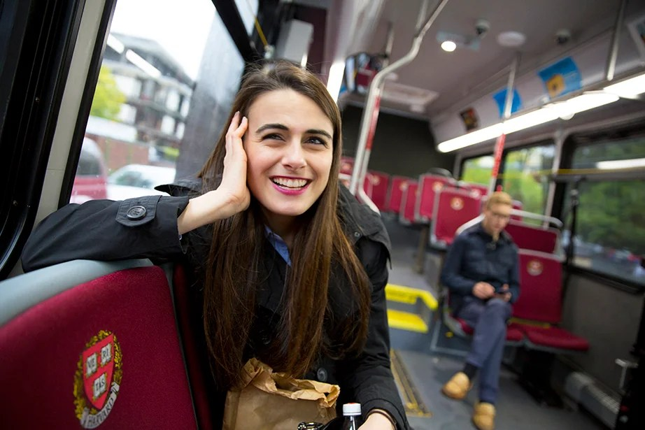 She rides the shuttle to Radcliffe Quad where she'll meet with other public service agents looking to hire Harvard students.