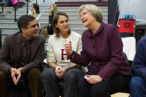 Women's basketball v. Cornell. Harvard won, 62-59. President Drew Gilpen Faust , right, was joined by Danoff Dean of Harvard College and Faculty Dean of Cabot House Rakesh Khurana, left, and his wife, Faculty Dean of Cabot House Stephanie Khurana on the Harvard bench as honorary coaches for the game. Jon Chase/Harvard Staff Photographer