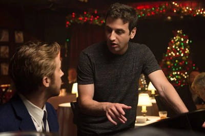 """Composer Justin Hurwitz speaks with actor Ryan Gosling on the set of """"La La Land."""" Hurwitz credits his Harvard education with opening up """"a lot of possibilities to me as a composer."""""""
