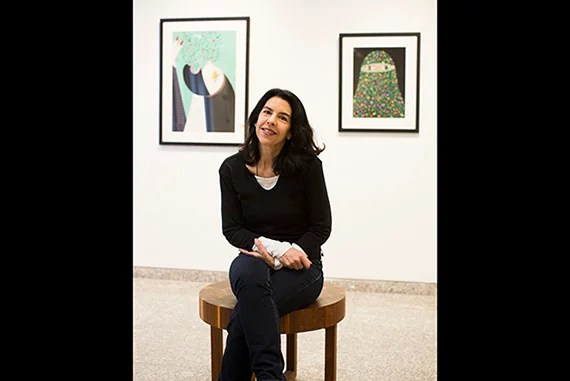 "Artist Helen Zughaib is pictured in the exhibition space in CGIS South. Her pieces ""Arab Spring Exodus"" and ""Arab Spring #2"" are hung behind her. Stephanie Mitchell/Harvard Staff Photographer"