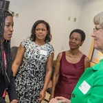 Harvard College graduate Shaunte Butler '14 (left), welcomes Harvard President Drew Faust to Miami Northwestern High School. Shaunte, who graduated from Northwestern, joined Faust to speak to current students about pursuing higher education.