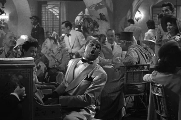 """One of the most misquoted lines from """"Casablanca"""" is """"Play it again, Sam."""" Bogart, who plays Rick, does say, """"Play it, Sam,"""" as he tries to drown his sorrows remembering his time with Ilsa, played by Ingrid Bergman. Credit: Wikimedia Commons"""