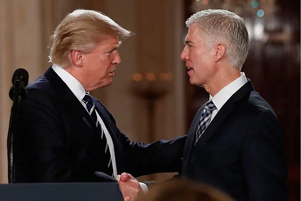 President Donald Trump shakes hands with 10th U.S. Circuit Court of Appeals Judge Neil Gorsuch, J.D. '91, his nominee for Supreme Court Justice.