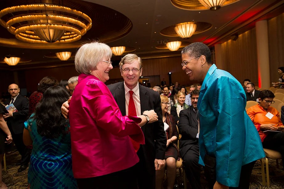 Drew Faust (from left) greets Harvard Divinity School Dean David Hempton and Harvard T.H. Chan School for Public Health Dean Michelle Williams following the Your Harvard Singapore program.