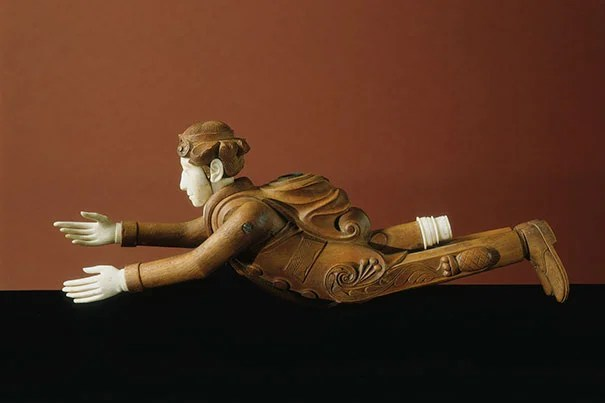 A hand-carved effigy pipe of a flying man dressed in a sailor's uniform, with an ornate pineapple design on his pants is one of the rarely seen treasures on exhibit. Gift of Frederick H. Rindge, Peabody Museum of Archaeology & Ethnology, © President and Fellows of Harvard College