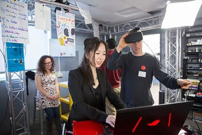 Divinity School student Ben Kurta (right) explores virtual reality with teaching fellow Bing Huang, Ph.D. '17, during the Derek Bok Center for Teaching and Learning's first capstone showcase.