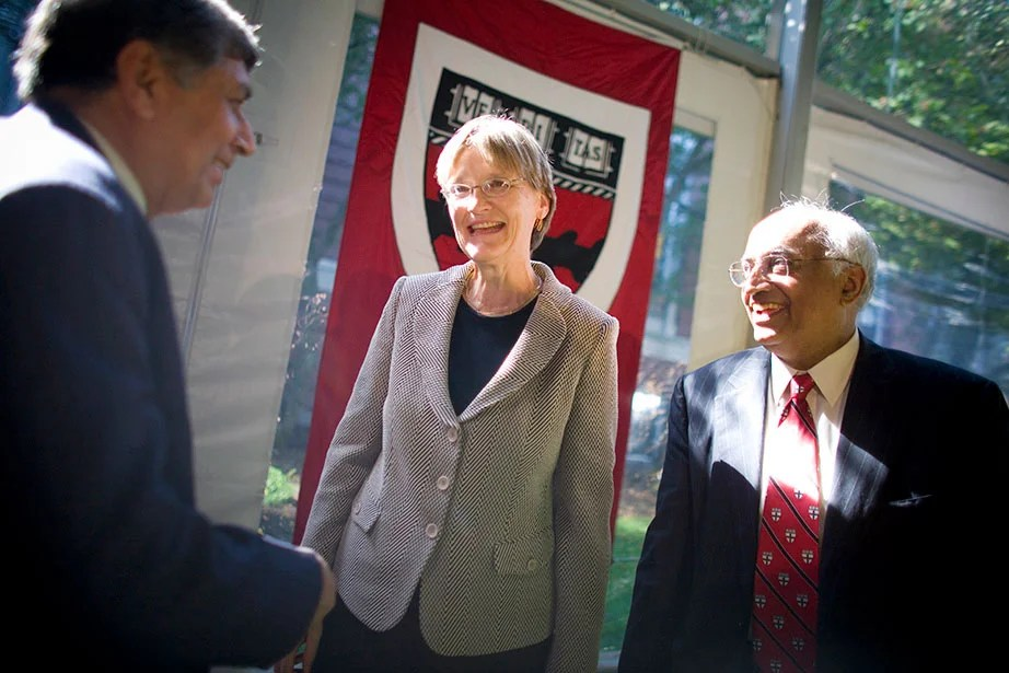 "President Faust (center) oversees the formation of the School of Engineering and Applied Sciences (SEAS)—the first new Harvard School since 1936. Dean Venkatesh ""Venky"" Narayanamurti (right), first dean of SEAS, is pictured here with Ashok Misra of the Indian Institute of Technology Bombay. In 2015, the School was renamed the Harvard John A. Paulson School of Engineering and Applied Sciences in recognition of Paulson's transformative $400 million gift. Photo by Justin Ide"