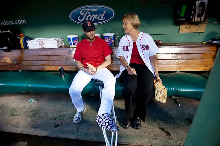 Before throwing out the first pitch at Fenway Park for the Boston Red Sox vs. Baltimore Orioles game in September 2010, President Faust meets Red Sox second baseman Dustin Pedroia in the dugout. Rose Lincoln/Harvard Staff Photographer