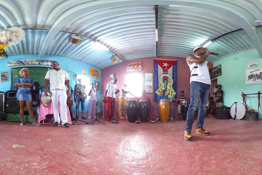 Los Muñequitos de Matanzas perform rumba, honoring African traditions through dance, chanting, and percussion.