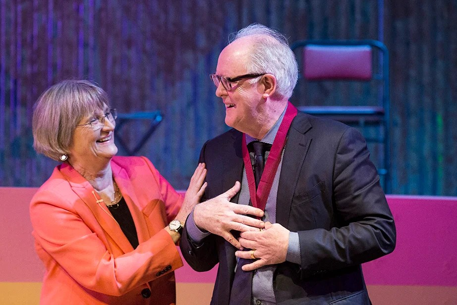 President Faust congratulates actor John Lithgow after he was awarded the 2017 Harvard Arts Medal.