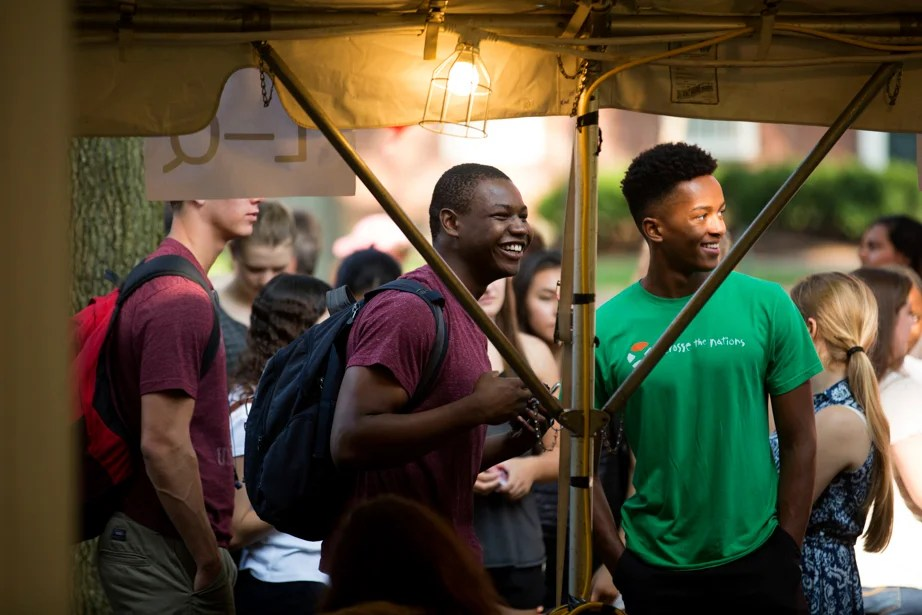 Freshmen Jude Tochukwu Okonkwo (left) and Destana Herring stand at the front of the line for their keys. Rose Lincoln/Harvard Staff Photographer