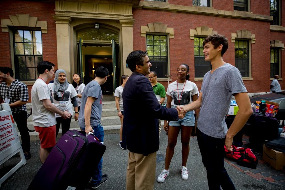 Dean of the College Rakesh Khurana greets students. Rose Lincoln/Harvard Staff Photographer