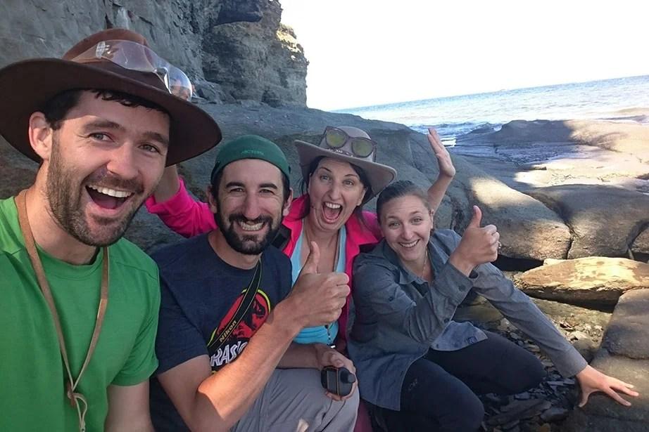 Harvard paleontologists celebrate the discovery of a new fossil site in Nova Scotia. From left, Blake Dickson, Chris Capobianco, Katrina Jones, and Stephanie Pierce.