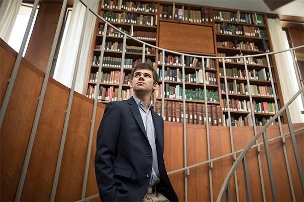 Matt DeShaw '17 is seen at the Leverett House Library at Harvard