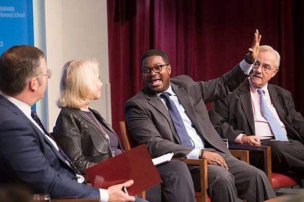 """At """"The Lure of the Prosperity Gospel in the Age of Trump,"""" panelist Jonathan Walton (center)  and E.J. Dionne (right) discussed the paradoxes of the evangelical tradition and how Trump has capitalized on its appeal to both rich and poor."""
