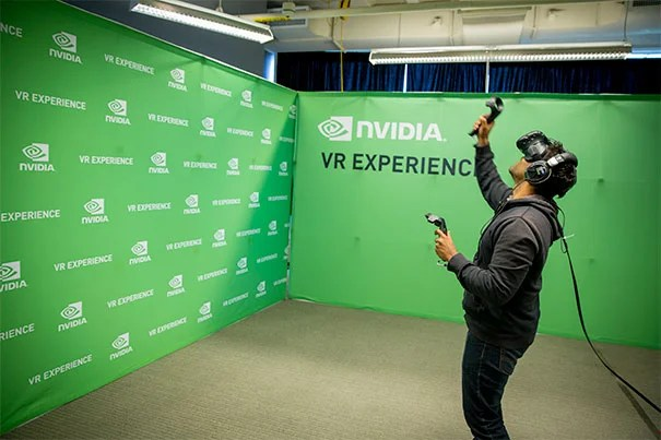 Rican Mohamed, HKS, '17 in a virtual reality space at the VR/AR Industry Fair in the i-lab during Hubweek 2015