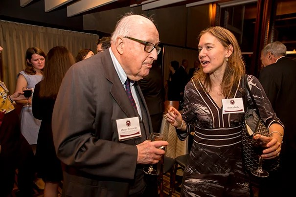 Henry Rosovsky (left), former Harvard professor and administrator, speaks with former student Jessica Roth at an event celebrating his 90th birthday and decades of service to the University.
