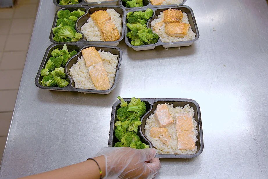 students package unused food for distribution to those in need