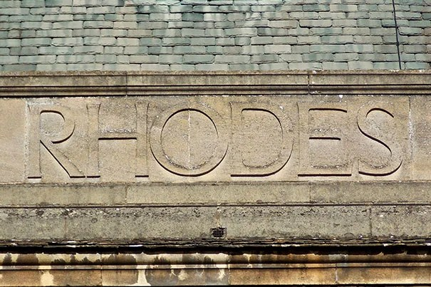 The photo of the embossed stone sign that reads Rhodes was taken at the back of the Rhodes House, the headquarters of the RhodesScholarships and the Rhodes Trust.