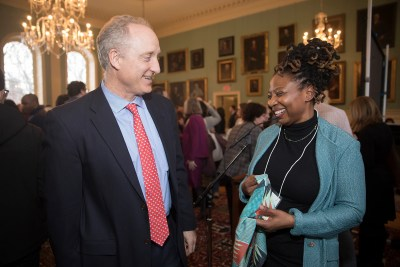 Edgerley Family Dean of the Faculty of Arts and Sciences Michael D. Smith congratulates Rosaline Salifu during the annual Dean's Distinction Awards inside University Hall.