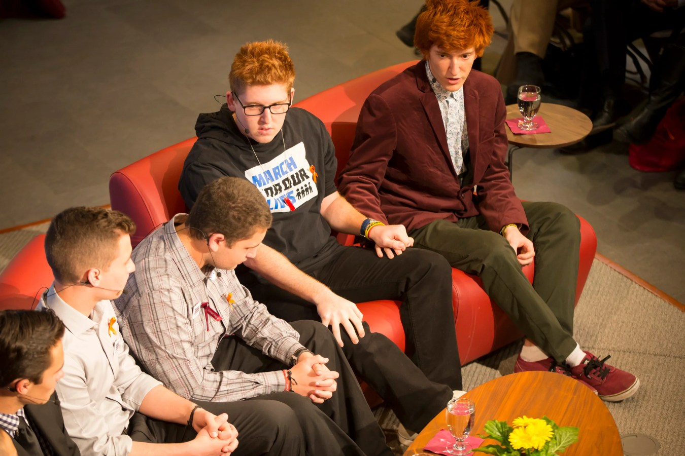 Brothers, Matt, left, and Ryan Deitsch clasp hands.