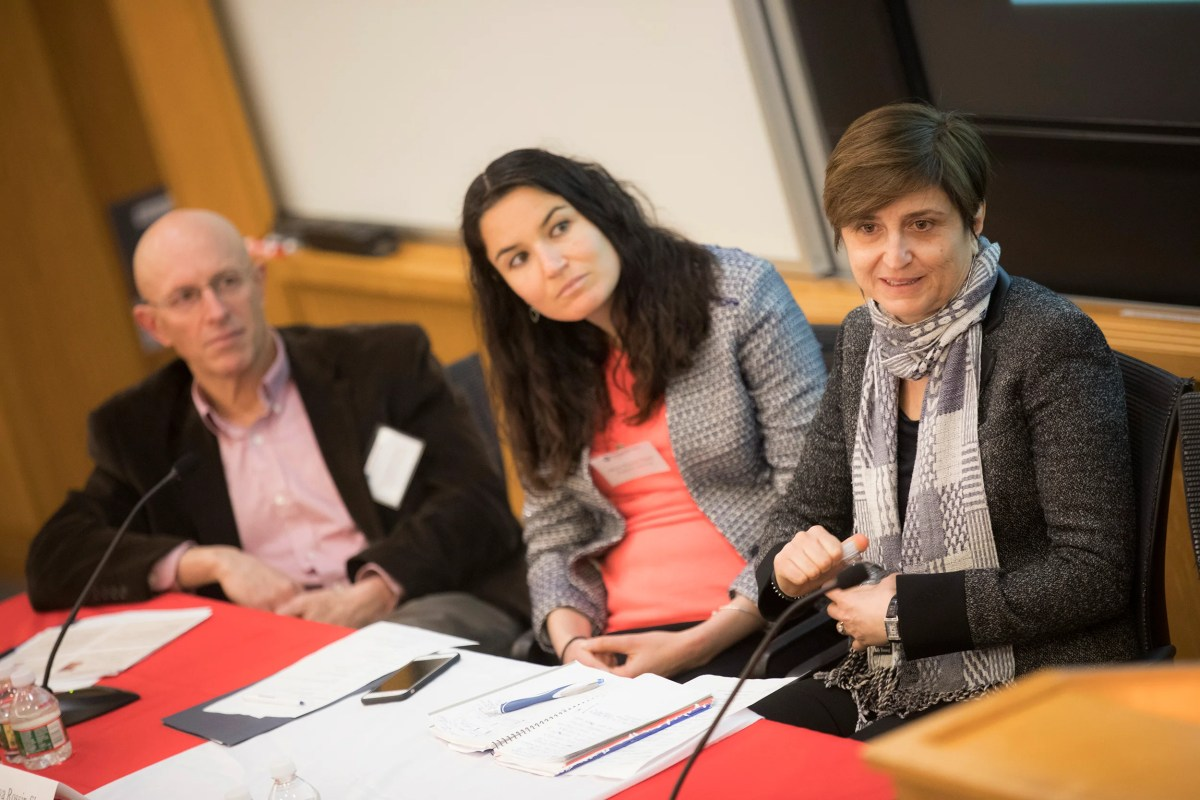 Christopher Ruhm (left), Maya Rossin-Slater, and Claudia Olivetti, take audience questions following their talk on parental leave in the developed world during a two-day conference on gender inequality.