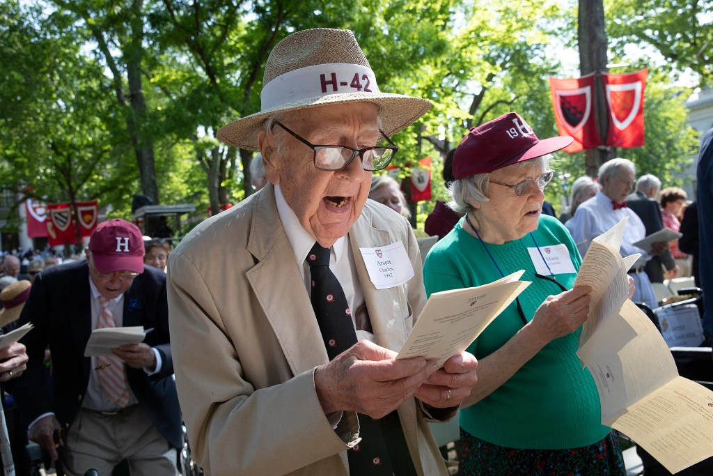 "Charles Arsen '42 and his wife, Marie, sing ""Fair Harvard."""