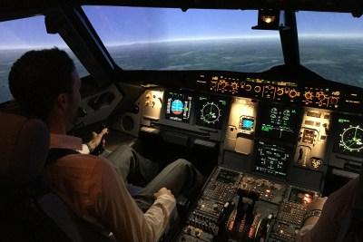 Pilot in cockpit.