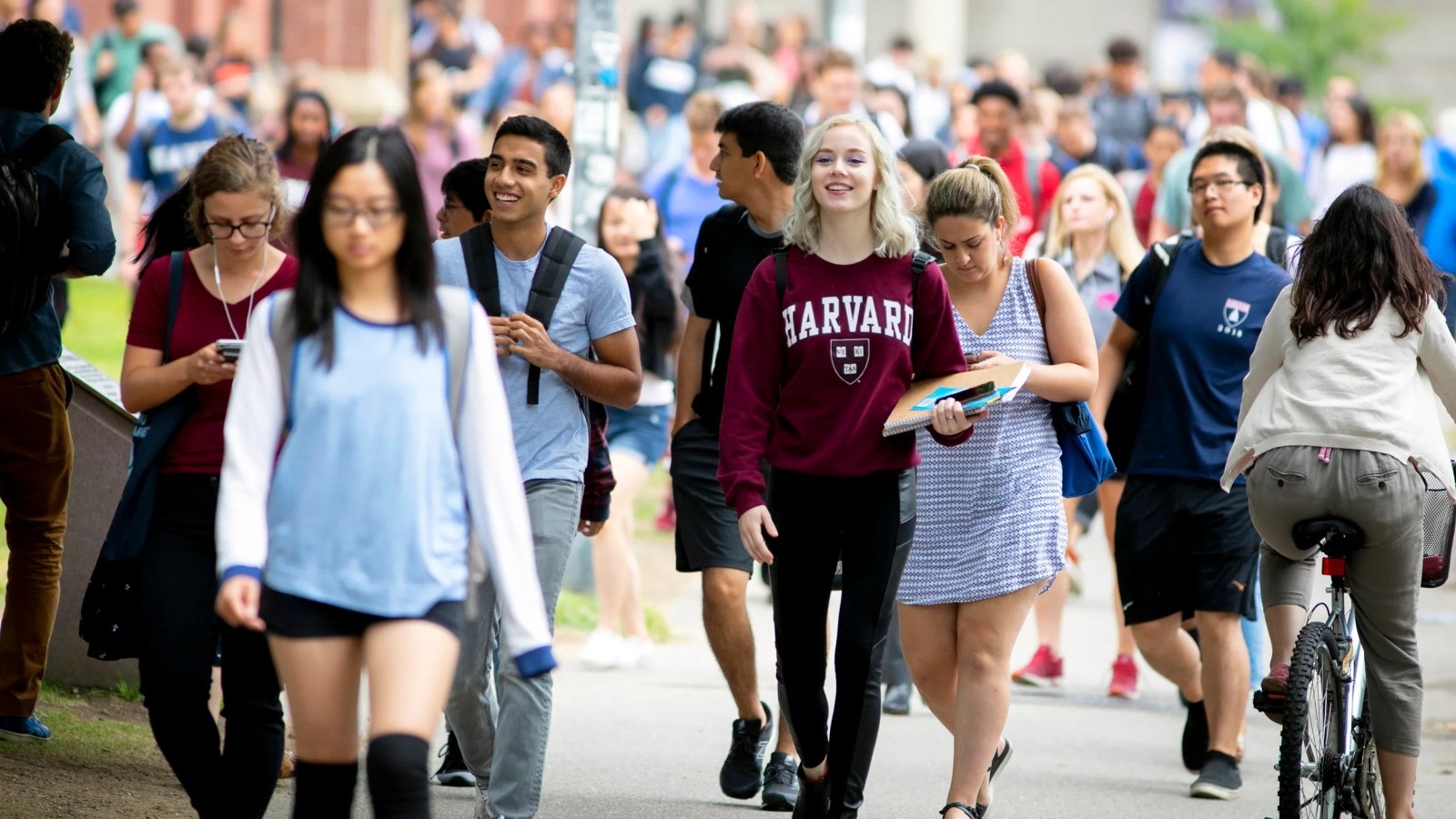 Students pass Memorial Hall on the first week of classes at Harvard College.