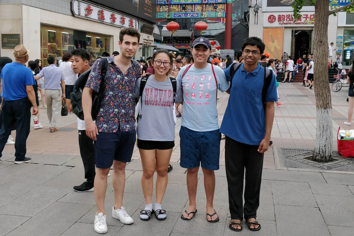 Harvard undergraduates Andrei Iliescu (from left), Irene Lu, Caleb Ren, and Adytia Mahadevan enjoy sightseeing on a cultural trip to Dong Hua Men Market.