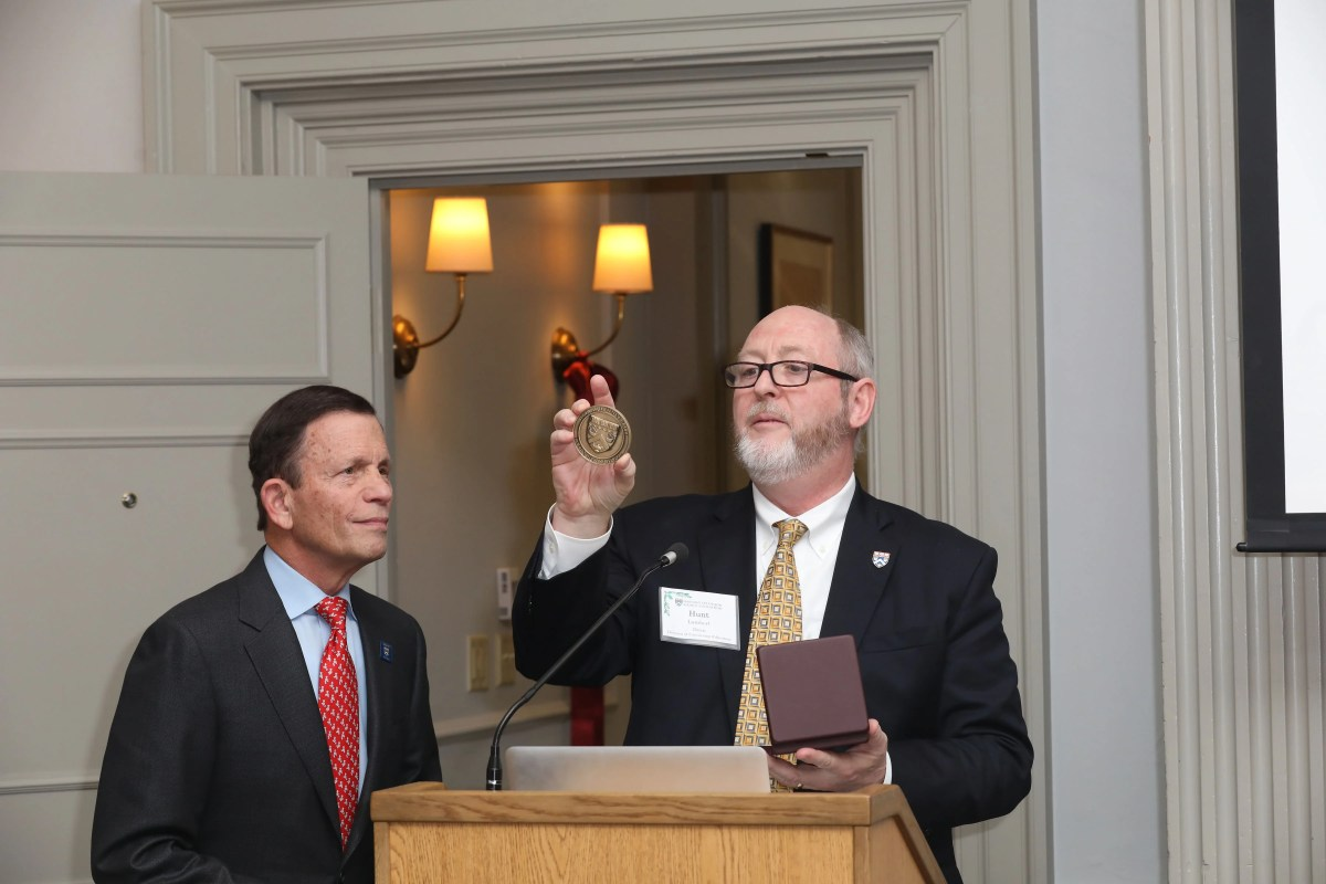 dgar Grossman's son Steven looks on as Dean Hunt Lambert present him with a medal honoring his father's contributions to Harvard Extension School (photo Alex Gagne)