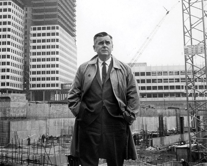 Ed Logue standing in front of Government Center construction