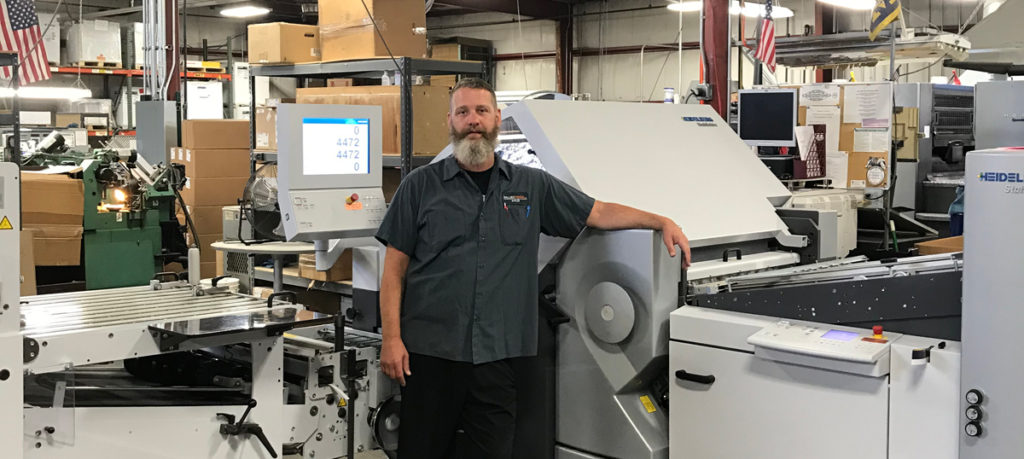 Rob French, Bindery Manager of Allied Media, with Stahlfolder KH 82