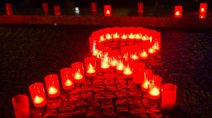 Candles form a red ribbon to mark World Aids Day