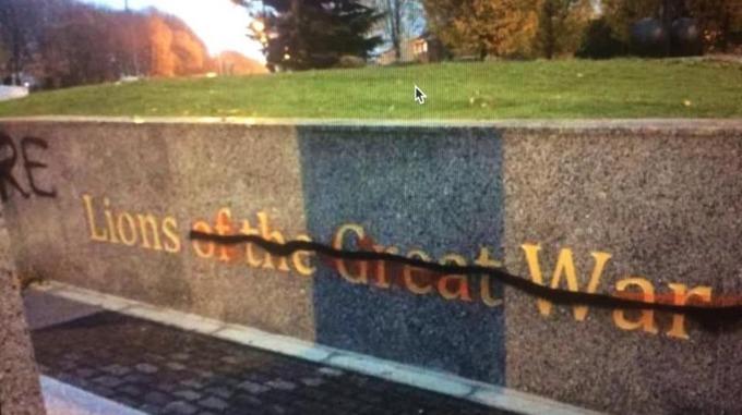 The war memorial was vandalised with black graffiti.