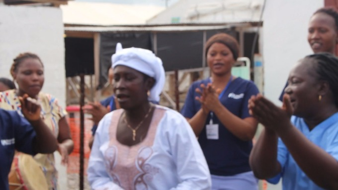 Medical staff clap as Ms Sankoh, thought to be the last survivor of Ebola, leaves the treatment centre