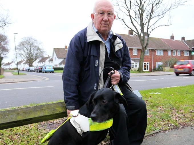 Guide dog Mia pictured with Sophie's dad, Norman Aston
