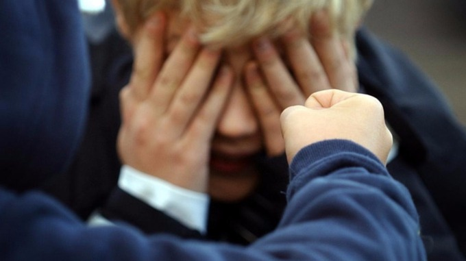 Posed photograph simulating a child being bullied.