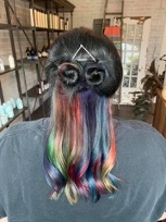 East Lansing hair stylist Bella Belknap bleached parts of this already-black here before applying colors to give it a rainbow effect.