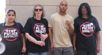 Landau participating in the 4-year anniversary commemoration of the life of Marvin Booker killed by Denver Sheriffs in 2010. Landau is joined by Tania Valenzuela of the Colorado Progressive Coalition on his extreme right, his mother on his right and on his left by the mother of Alonzo Ashley, Gail Waters. Alonzo Ashley was killed at the Denver Zoo in 2011 by Denver Police.