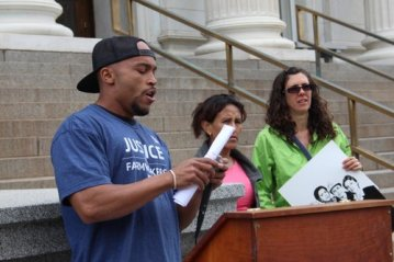 Landau speaking to a crowd before a Senate Committee hearing February 24, 2013 against bed quotas at for-profit prisons.