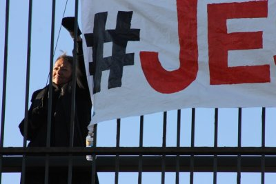 Lynn Eagle Feather mourns the death of Jessica Hernandez by participating in the banner drop.