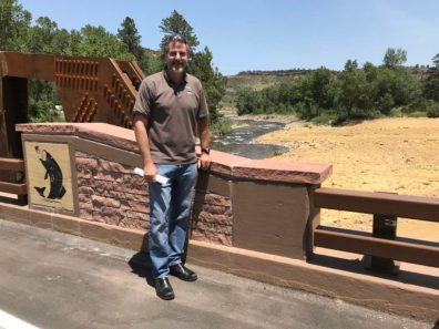 Boulder County Parks and Recreation Director in front of St. Vrain River
