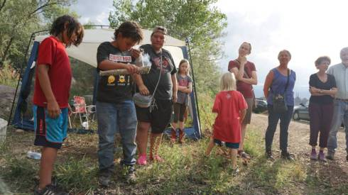 Oglala Lakota youth smugges with sage after the day's ride