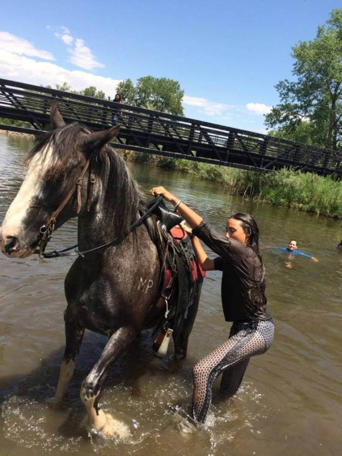 Sierra Ventimiglia takes advantage of the oportunity to take swim with her horse