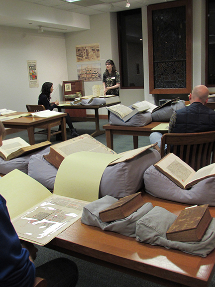 Nora Epstein with Karen Scott's History 323 course in the Special Collections and Archives Reading Room