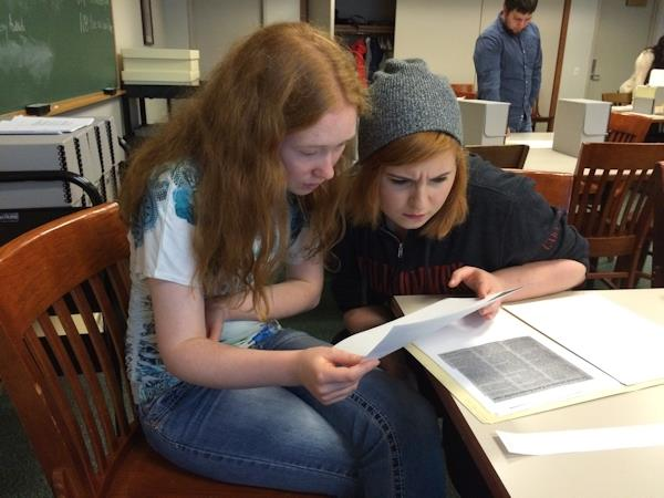 High school students examine archival documents